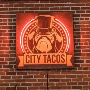 neon sign of City Taco's logo