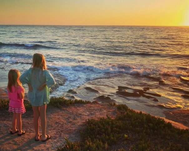 Girls looking at sunset